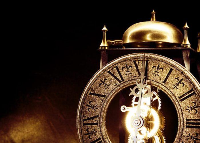Antique Clock With Bell On Top On Dark Background